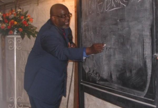 Daryl Holt uses blackboard to